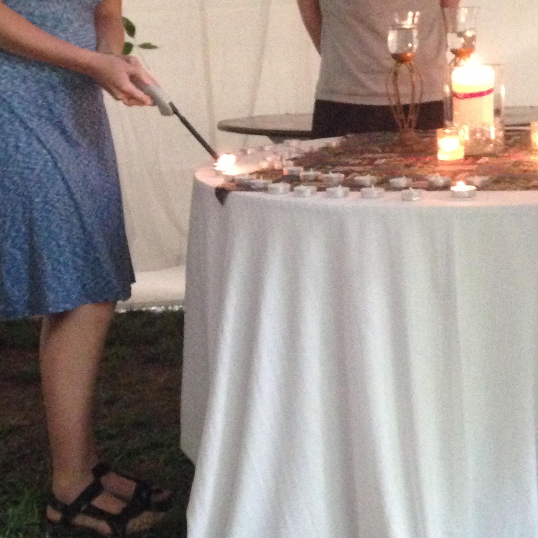 Lighting the Shabbat candles.