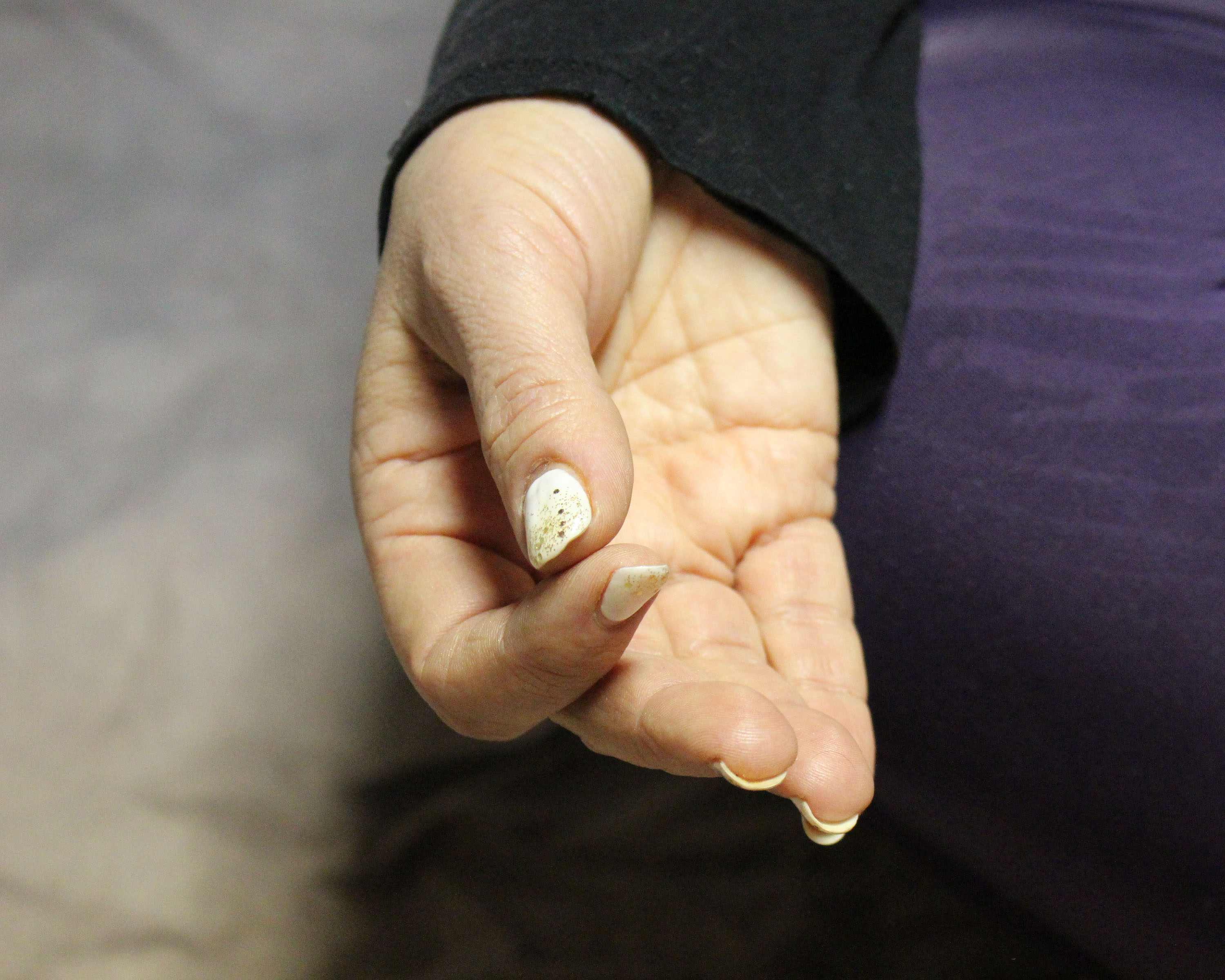 Nicole's hand in a meditation position called Gyan Mudra