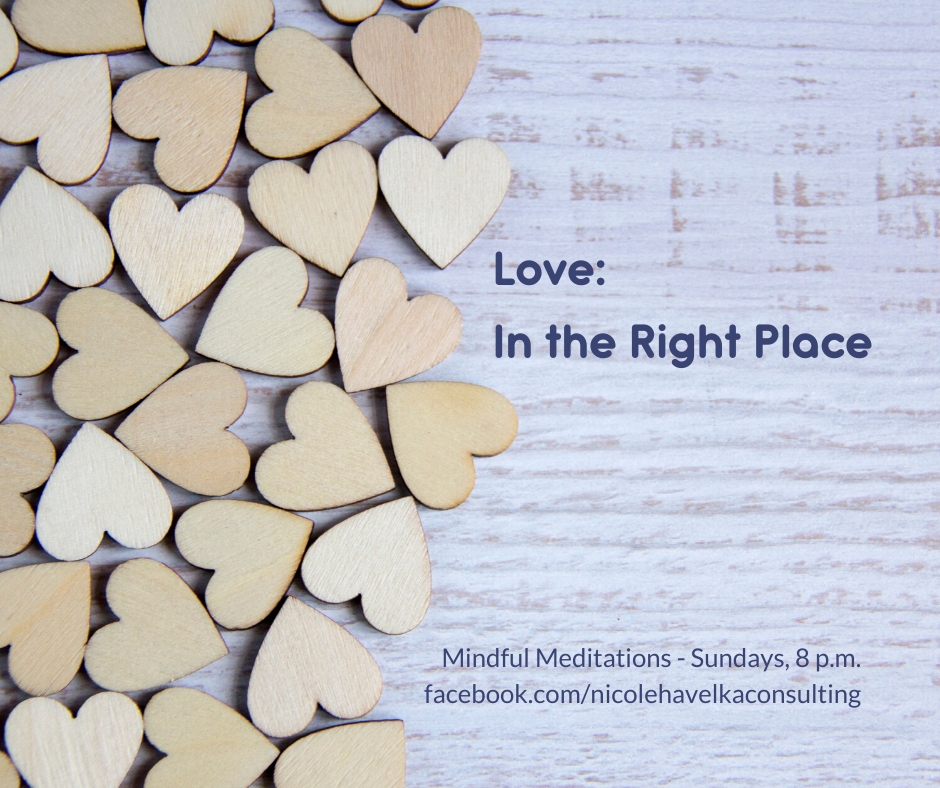 Mindful Advent: Love Graphic with wooden hearts against a background of a wooden plank.