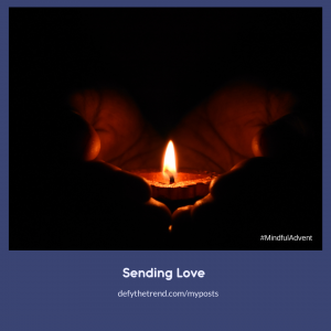 Image of hands holding a single candle in the dark with a banner below saying: Breathing Joy, defythetrend.com/myposts