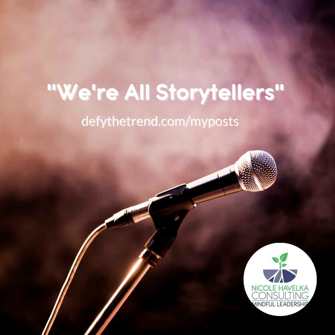 """Spotlight of a microphone in a dark smoky room with the words over it: """"We're All Storytellers."""" defythetrend.com/myposts"""""""