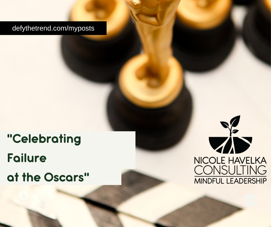 """Image of the base of awards statues in the upper right corner with a director's clapperboard in the bottom left corner. The words, """"defythetrend.com/myposts"""" in upper left, the words, """"Celebrating Failure at the Oscars in the bottom left"""""""
