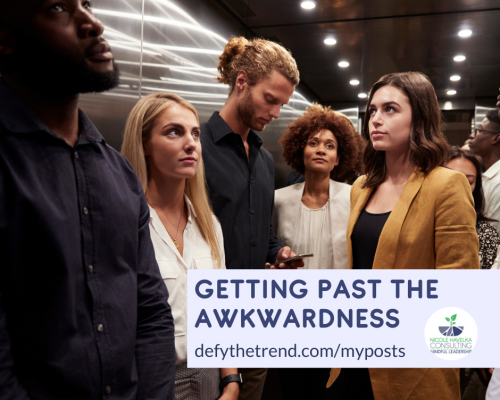 """Photo of 5 people or mixed races occupying the same small space, all of them are diverting there eyes, one person is staring at his phone. The words, """"Getting Past the Awkwardness, defythetrend.com/myposts"""" is in the lower right hand corner over a light purple background."""