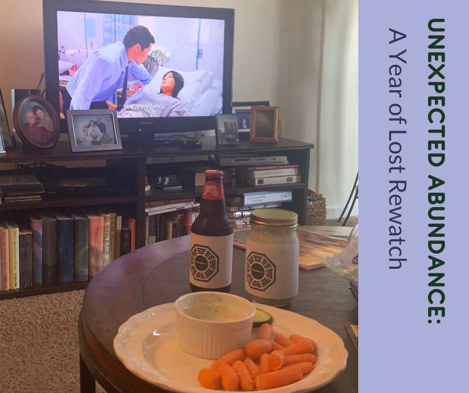 Image of Nicole's coffee table with two bottles with Dharma Initiative labels on them. The television is on in the background with a scene from the series finale of the ABC series Lost.