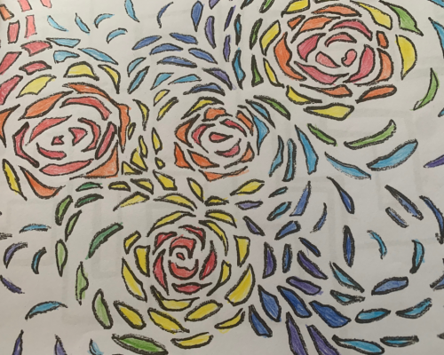 Photo of an coloring page with abstract flower shaped designs colored in reds, oranges, purples, blues and greens.