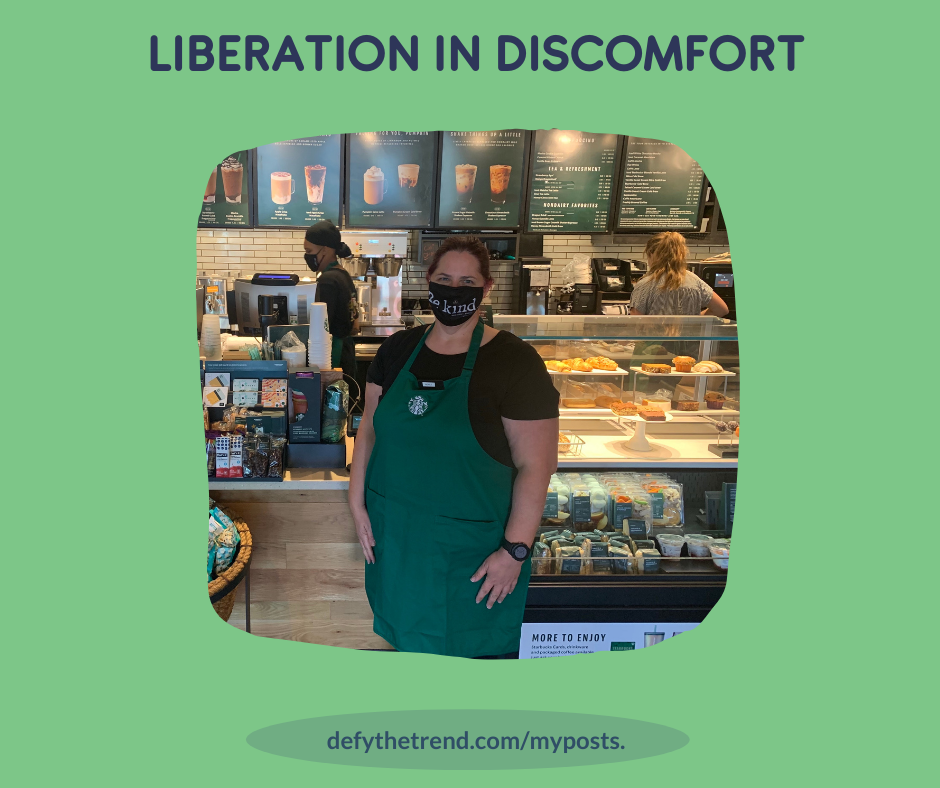 """Light green background with a headline, photo and subhead. The headline is, """"Liberation in Discomfort."""" The photo is of Nicole posing in front of the register at her first day a Starbucks. Subhead is, """"defythetrend.com/myposts; link in bio"""""""